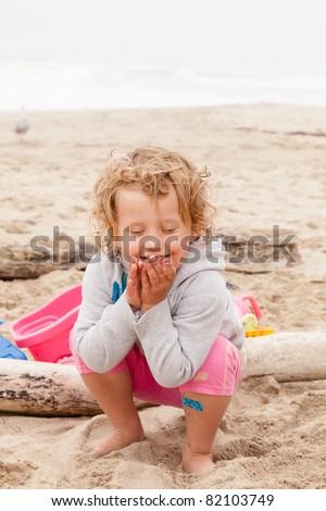 Having fun with sand on the beach. - stock photo