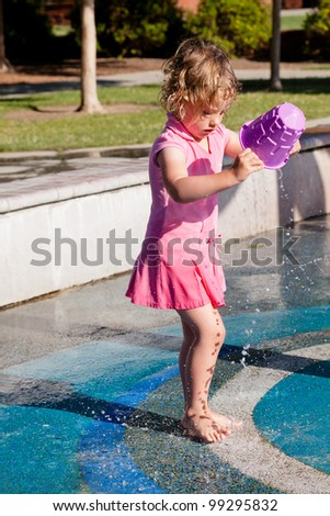 Having fun with water at the playground in park