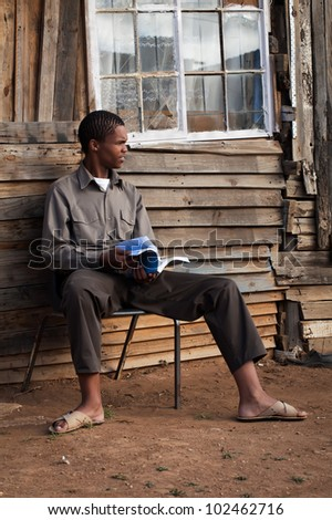 Having the courage to study by himself - stock photo
