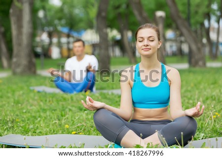 Having yoga practice in park