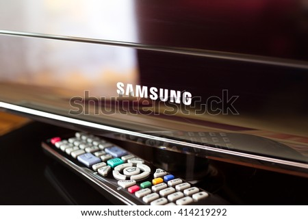 HAVIROV, CZECH REPUBLIC - MAY 2, 2016: Modern black television and remote control. Samsung is South Korean multinational conglomerate company. One group of company is focused on electronics industry