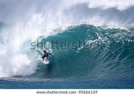 HAWAII - DECEMBER 9: Australian Josh Kerr competes in the Billabong Pipemasters on December 9, 2011 at Pipeline, Hawaii. This years event produced some of the biggest waves in recent years. - stock photo
