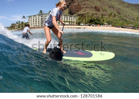 HAWAII - FEBRUARY 16: Candice Applebee competes in the stand up paddle division during the Buffalo's Big Board Classic on February 16, 2013 at Makaha Beach.