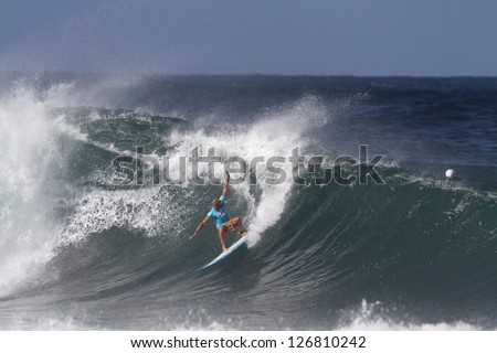 HAWAII - FEBRUARY 1: Dane Gudauskas competes in the Volcom Pipe Pro where the waves were ten to fifteen feet February 1, 2013 on the North Shore of Hawaii. - stock photo