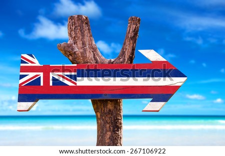 Hawaii Flag sign with a beach background - stock photo