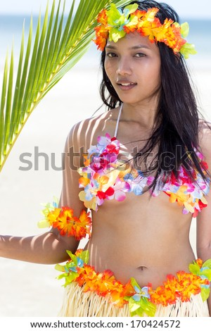 Hawaii Hula dancer on beach - stock photo