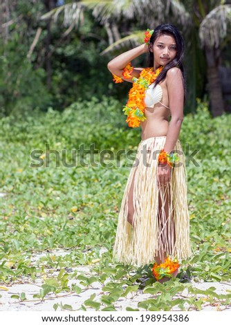 hawaii hula dancer posing in nature - stock photo