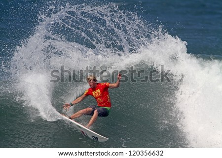 HAWAII - NOVEMBER 24: John John Florence takes second place at the Reef Hawaiian Pro, stage one of the Vans Triple Crown of Surfing November 24, 2012 at Haleiwa Beach Park. - stock photo