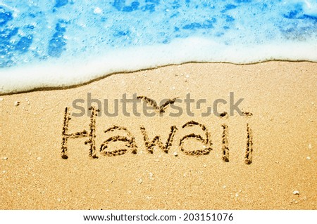Hawaii written in the sand at the beach. Travel concept.  - stock photo