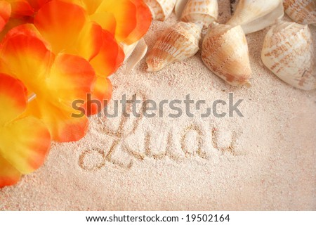 hawaiian beach background with the words luau on the  tropical sand with seashells and a lei - stock photo