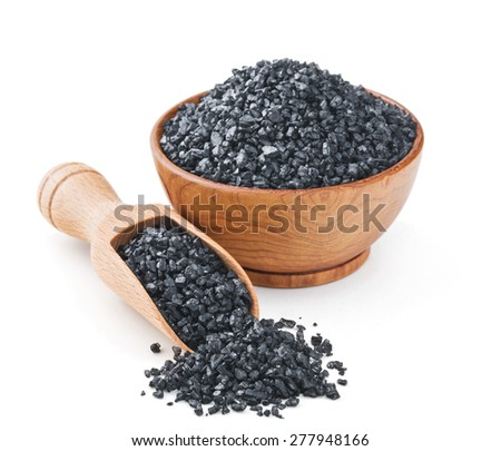 Hawaiian black volcanic salt in a wooden bowl isolated on white background