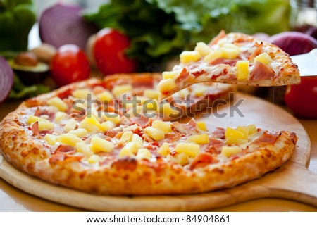 Hawaiian Pizza lifted slice 2 - stock photo