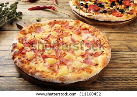 hawaiian  pizza  rustic table background - stock photo