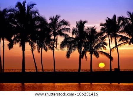 Hawaiian Sunset on Big Island Anaehoomalu Bay - stock photo