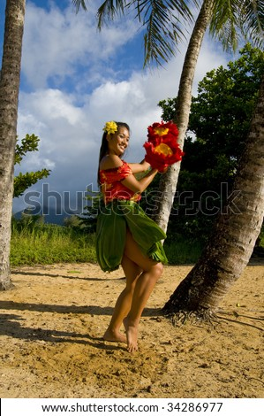 Hawaiian teenage girl dancing Hula on the beach in Kauai - stock photo