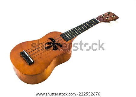 Hawaiian Ukelele 1. A Hawaiian style ukelele with a sound hole in the shape of a palm tree. Isolated on white.