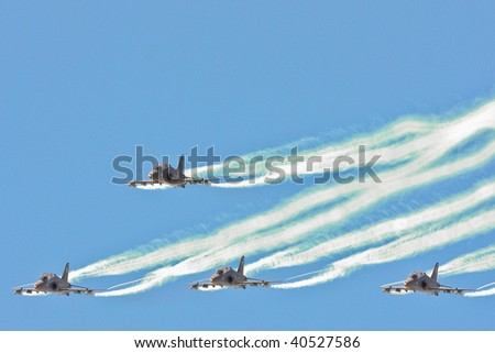 Hawk trainer jets flying in close formation - stock photo