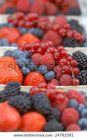Hawker's stand with different berries. Shallow depth of field.