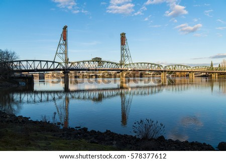 Hawthorne Bridge and Reflection over Willamette River, Sky in Portland Oregon