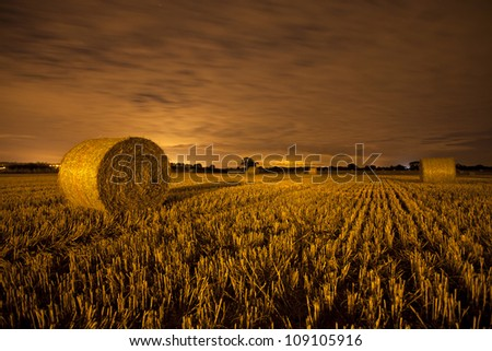hay bails in a field in england during summer, farming - stock photo