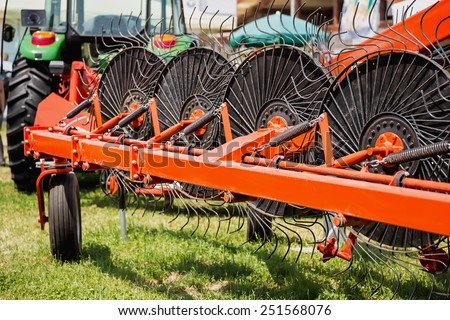 Hay rake farm machinery equipment in agricultural or farmland industry