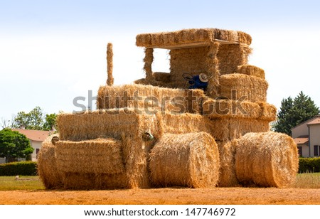 Hay tractor with sleeping man  France - stock photo