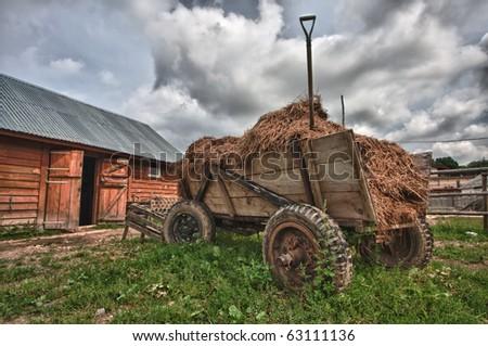hay wagon at the farm - stock photo