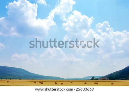 Hayfield with holy light in Burgundy, France - stock photo