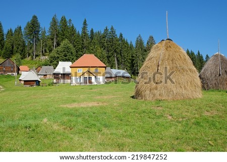 haystack and Kamena Gora village, Serbia - stock photo