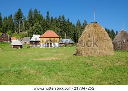 haystack and Kamena Gora village, Serbia - stock photo