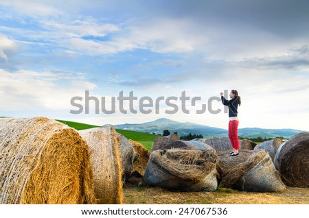 Haystack at sunset, Tuscany landscape, Toscana, Italy - stock photo