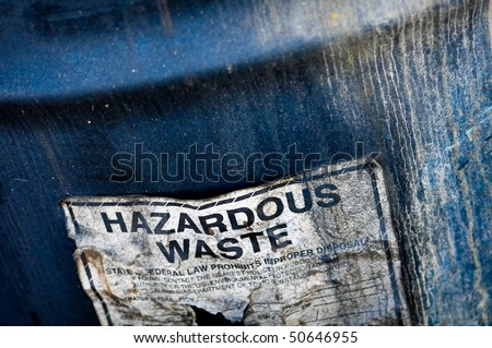 Hazardous and Toxic Waste Barrels storing pollution - stock photo