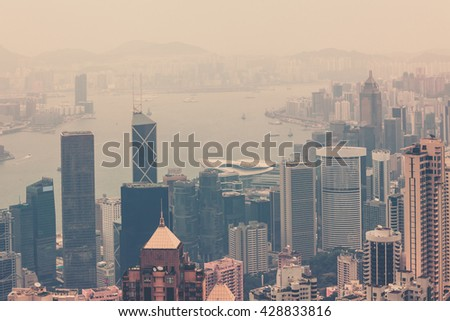 Haze Hong Kong downtown view from Victoria peak. Filtered shot - stock photo