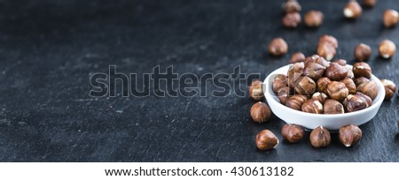Hazelnut Kernels (selective focus; close-up shot) on vintage looking background - stock photo
