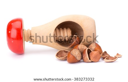 Hazelnut or filbert nut with nut cracker isolated on white background cutout - stock photo