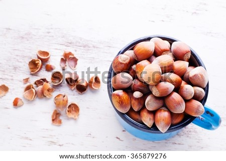 hazelnuts in a mug. top view - stock photo