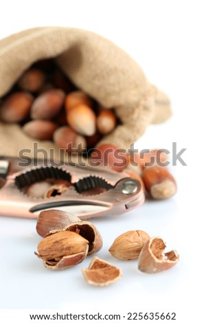 Hazelnuts in bag isolated on white