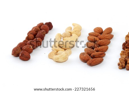hazelnuts, Migdal , walnut, cashew nuts , white background , pigtails, mix lot , close up, row , pure lies , beautiful , picture, eat, food, winter, summer , fall, spring , vitamins, collection ,