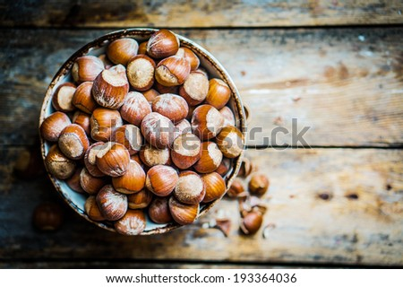 Hazelnuts on rustic wooden background - stock photo