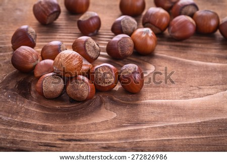 hazelnuts on  vintage  wooden board food and drink concept  - stock photo