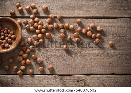 Hazelnuts on wooden background