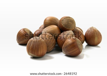 hazelnuts over white background