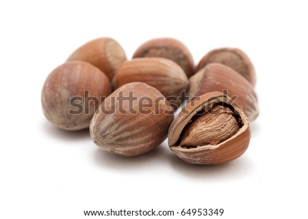hazelnuts with a cracked one isolated on white