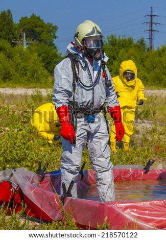 Hazmat team members have been wearing protective suits to protect them from hazardous materials - stock photo