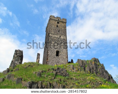 Hazmburk gothic castle on rocky mountain in Ceske Stredohori, Czech republic. - stock photo