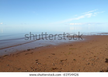 Hazy hot sky over the water with room for your text - stock photo