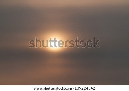 Hazy sunset with cloudscape   - stock photo
