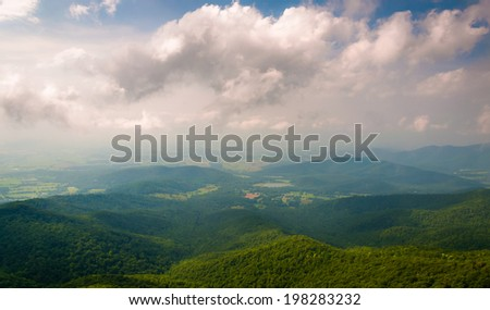 Hazy view of the Shenandoah Valley from Little Stony Man Cliffs in Shenandoah National Park, Virginia. - stock photo