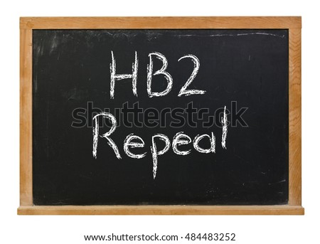 HB2 repeal written in white chalk on a black chalkboard isolated on white
