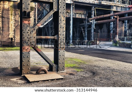 HDR filtered image of the Landschaftspark Duisburg-Nord, a public park in the German city of Duisburg. The centerpiece of the park is formed by the ruins of a blast furnace complex shut down in 1985. - stock photo